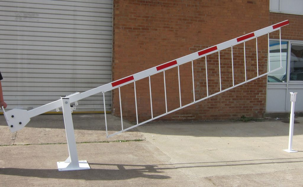 Manual barrier with drop skirt