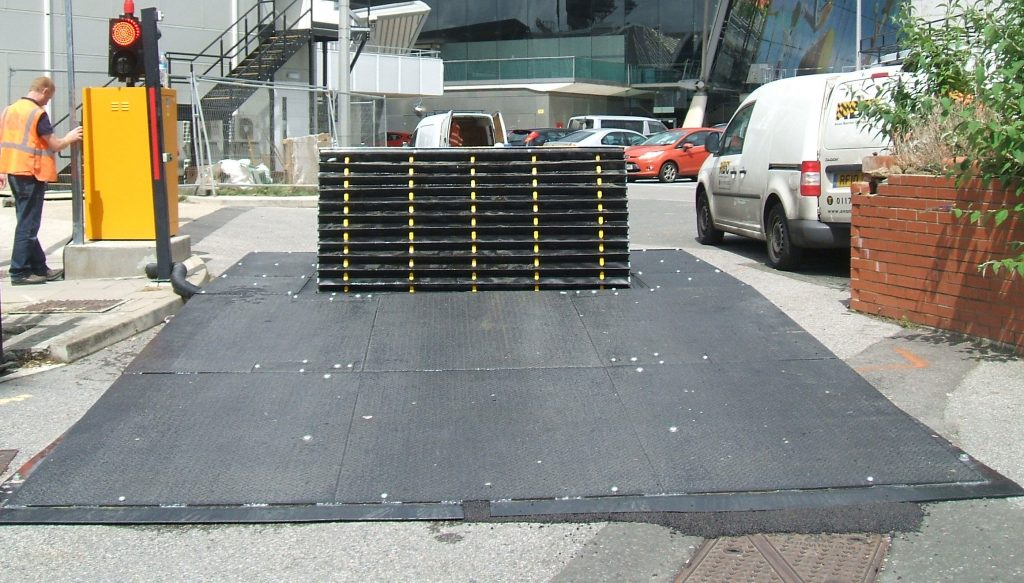 Surface PAS68 road blocker with safety debris skirt